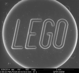 Lego at 57x. The gray scale is typical of unprocessed SEM imaging